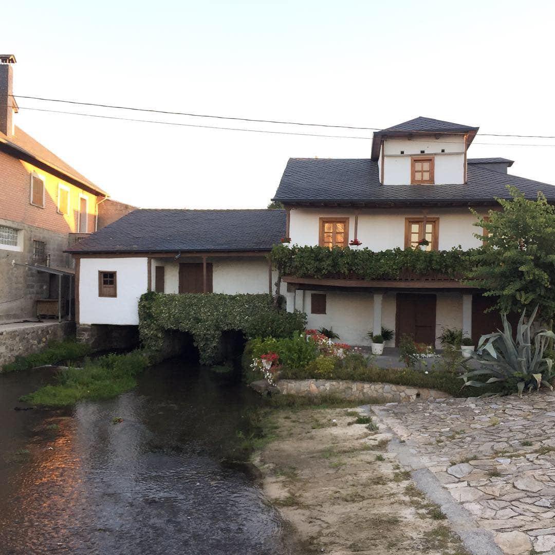 A cool house with a river running through it