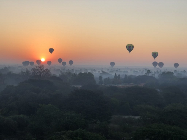 Sunrise with hot air balloons over Bagan