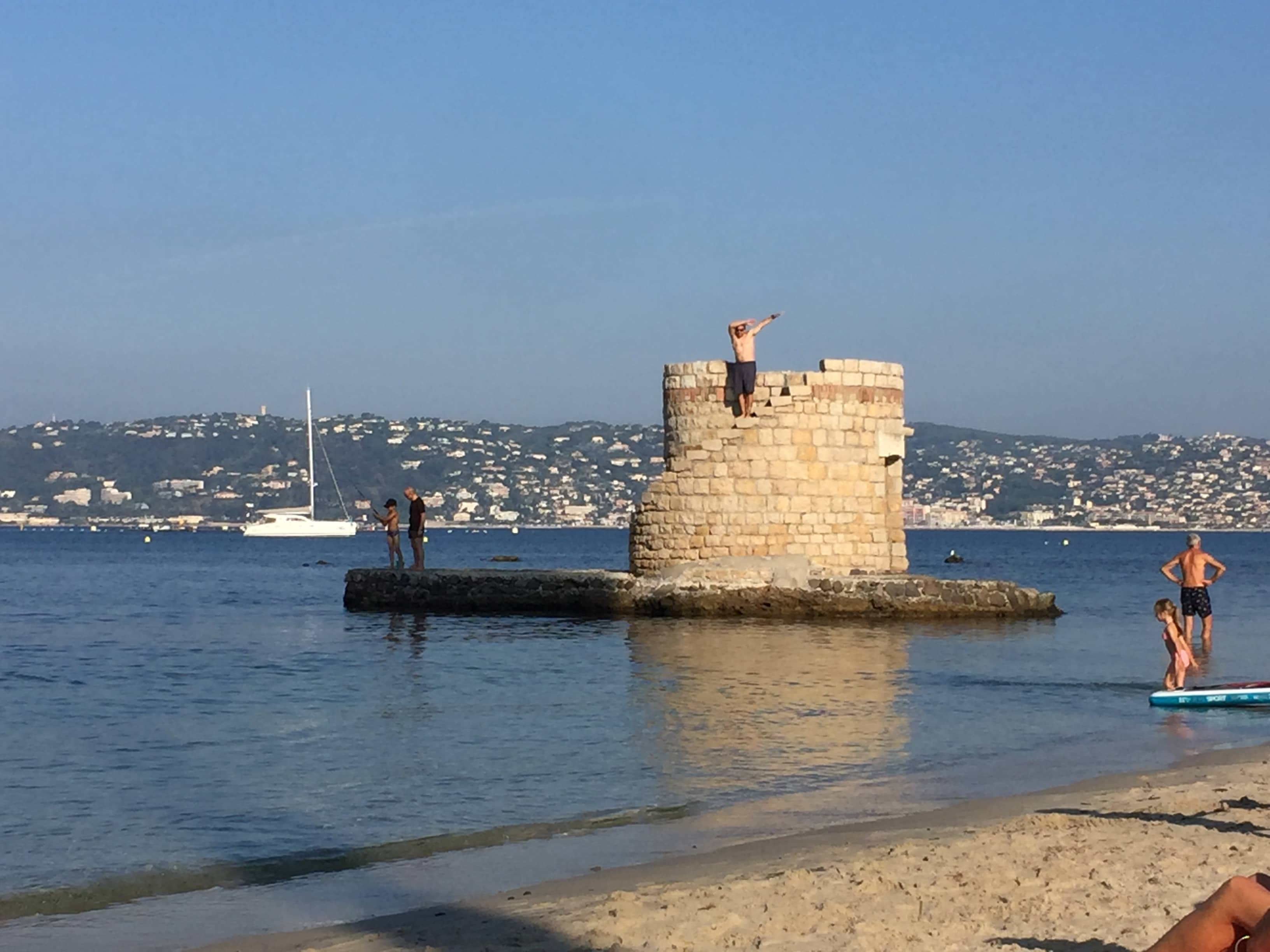 "Luc playing the ""king of the castle"" at the beach"
