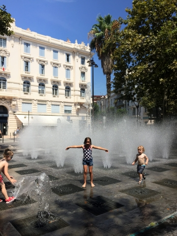 Cooling off at the inground fountains in Antibes