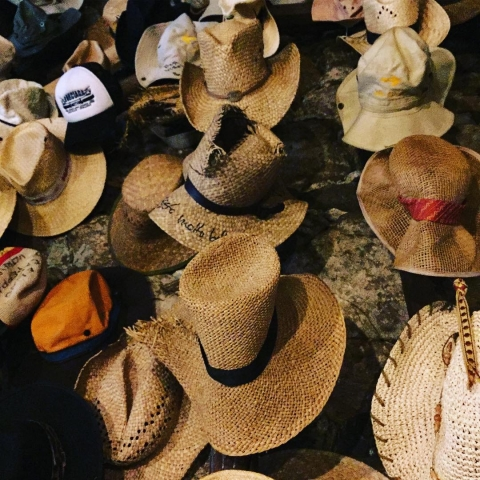 many hats at the coffee shop